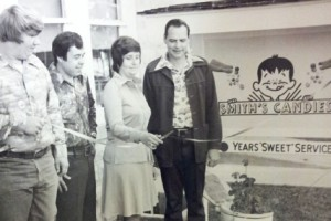 © J. Smith John R. Smith and his wife Shirley cutting the ribbon for the opening of the new Smith's Candies warehouse and retail store.